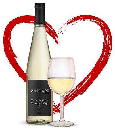 Bottle of wine and wine glass in front of the outline of a red heart.
